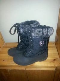 pair of black leather boots Calgary, T2A 4T7