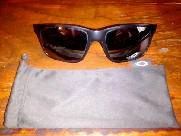 black sunglasses with gray pouch