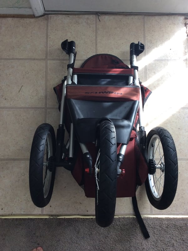 Black and red Stroller 4dca2ea9-1816-49e6-a94f-213639222ca6