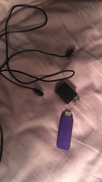 Purple Roku dongle and black adapter Freehold township, 07728