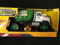 green and white Tonka dumptruck toy with box