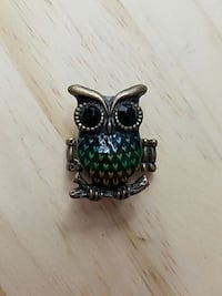 silver, black, and green owl decor Burbank, 91506