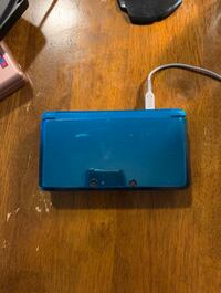 Nintendo 3D DS, charging station, and charging cord