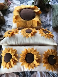 white and yellow sunflower pillows