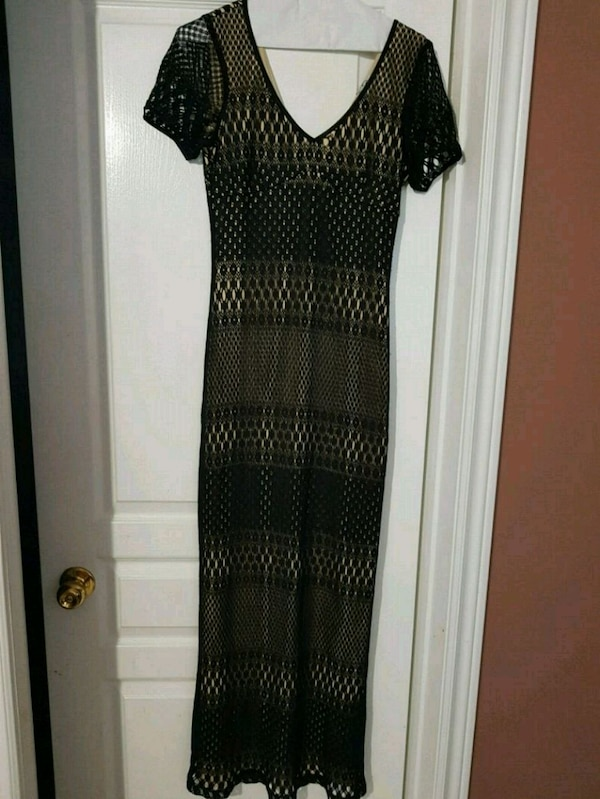women's brown and black dress 5d77c134-14ea-4631-bb7c-9c34a625caa7