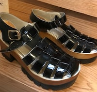 Pair of black-and-silver sandals Toronto, M6M 5K9