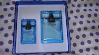 two blue and black leather wallets Surrey