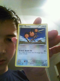 white and blue Pokemon trading card 1026 mi