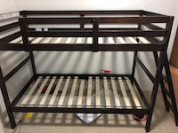 brown and white slatted bunk bed