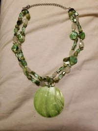 Green beaded necklace with a large green pendant  Minneapolis