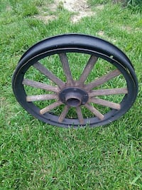 Model T wood spoke wheel.  Lamar, 64759