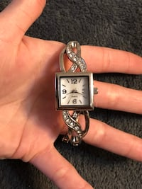 Silver and black analog watch