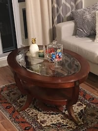 round brown wooden framed glass top coffee table Toronto, M6A 1L7