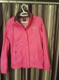 pink and black zip-up The North Face jacket 1414 km