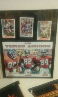 two black wooden framed photo of football players Denver