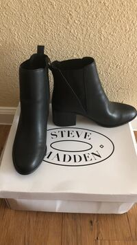 Pair of black steve madden leather chunky heeled chelsea boots