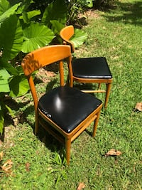 Brown wooden framed black leather padded chair New Orleans, 70121
