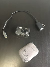 grey Samsung compact camera with charger and pouch