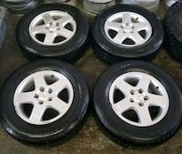 Pontiac torrent rims and tires all season  Toronto, M6L 1A4