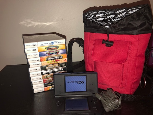 black Nintendo DS with game cases