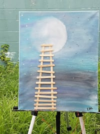 Moon and ladder art glows in the dark. Art