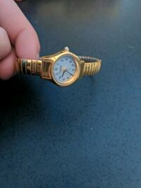 round gold analog watch with gold link bracelet Mount Airy, 21771