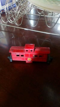 red and white plastic toy truck