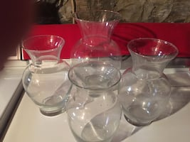 4 clear glass  vases.