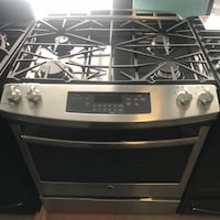 GE stainless steel slide in gas stove 90 days warranty Reisterstown, 21136