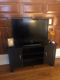 Black flat screen tv with brown wooden tv hutch Washington, 20005