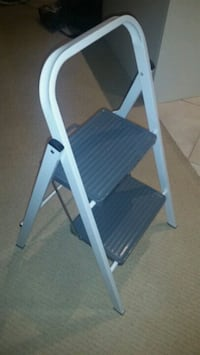 white and blue wooden folding chair