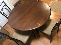 Brown wood kitchen table  371 mi