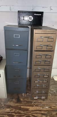 Two Gray And Black Metal Filing Cabinets