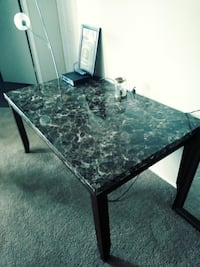 rectangular black marble top table