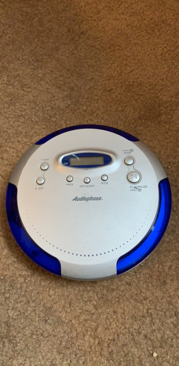 white and blue Philips portable speaker