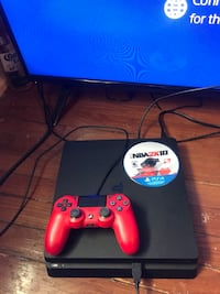 blue Sony PS4 with red DualShock 4 274 mi