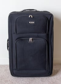 Black Delsey checked luggage suitcase San Francisco