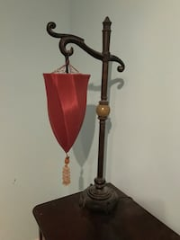 Red lamp with tassel. need gone !