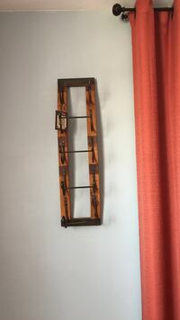 Brown and black wooden floating wine rack New York, 11374