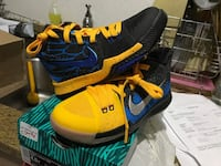 pair of blue-and-yellow Nike basketball shoes Baltimore