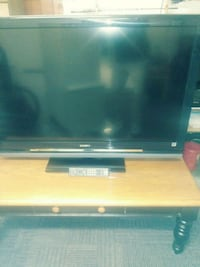 black flat screen TV with remote Clayton, 27520