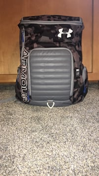 Black, gray, and blue Under Armour camouflage backpack.