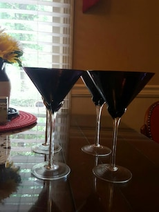 four blue footed martini glasses