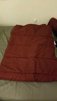Red IKEA twin size light comforter & blue bed cove