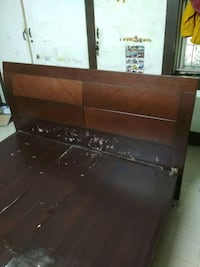 brown wooden bed headboard and footboard
