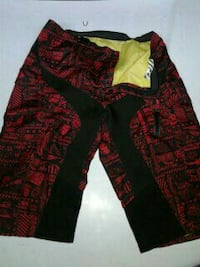 black and red board shorts