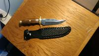 brown wooden handled survival knife with sheath