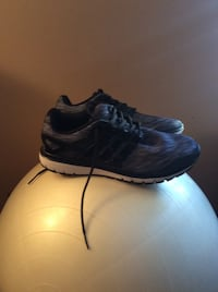 Pair of Adidas low-top shoes  894 mi