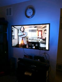 black flat screen TV with black TV stand Broomfield
