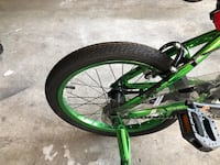 Green and black full suspension bicycle Dover, 19904